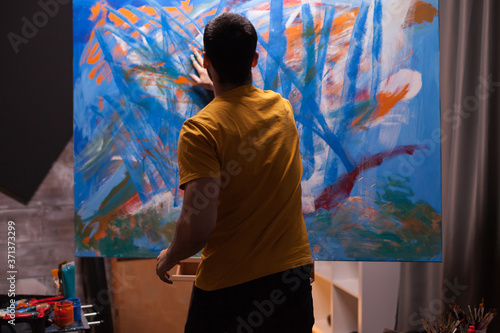 Fotomural Artist working on painting in art workshop