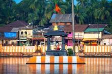 27.12.2019 Gokarna, Karnataka, Colorful Indian Koteshwar Temple Bright Orange-striped On The Bank Of Sacred Lake Koti Teertha. The City Is A Holy Pilgrimage Site For Hinduists