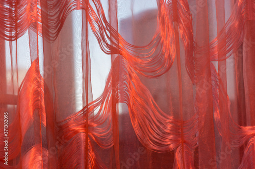 Fotografering A picture of a curtain with a red light filter