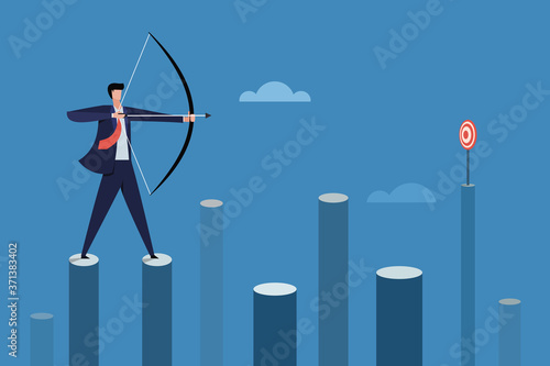 Photo Businessman standing on high pillars aiming target with bow and arrow