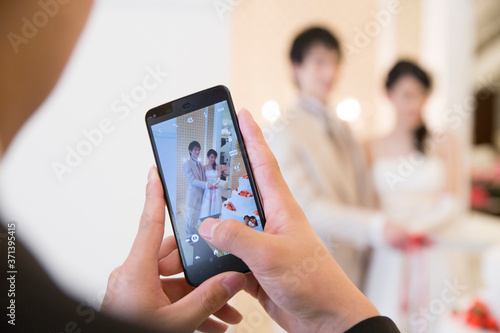 Fotografie, Obraz 結婚式の写真を撮る女性