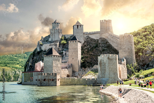 Leinwand Poster old castle in the river. golubac
