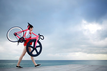 Full Length Portrait Of Stylish Woman Dressed In Sport Suit Holding Her Light Weight Fixed Gear Bike While Walking Along Concrete Pier, Hipster Girl Stroll With Bicycle At Seashore With Copy Space Sky