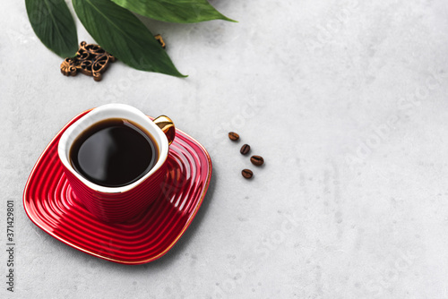 Fototapeta space coffee in red cup and coffee bean with leaf food background