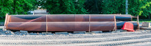 Several Large Black Water System Pipes Stacked On Top Of Each Other