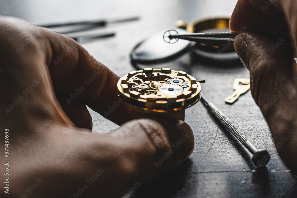 Fototapeta Watchmaker is repearing mechanical wrist watch