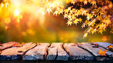 Wooden Table With Red And Yellow Leaves At Sunset - Autumn Background