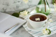 A Cup Of Tea And Jasmine Flowe...