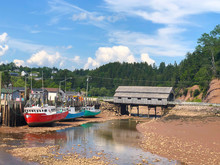 Colorful  Fishing Boats At Low Tide In New Brunswick Canada