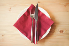 Close Up Of Silverware, Napkin And Side Plate