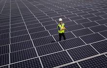 Caucasian Technician Smiling On Solar Panels