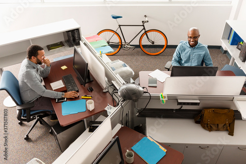 Men working at computers in office