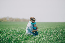 Father With Son (2-3) In Green Field