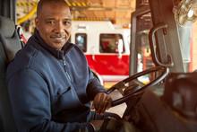 Portrait Of Fireman Sitting In...