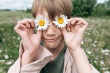 Close-up Of Boy Hiding Eyes Wi...