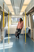 Afro Young Man With Bag Standing In Train, Miami, Florida, USA