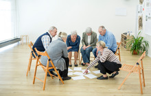 Group Of Seniors In Retirement Home Evaluating Result Of Group Therapy