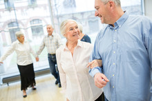 Group Of Active Senior Attending Dance Course In Retirement Home