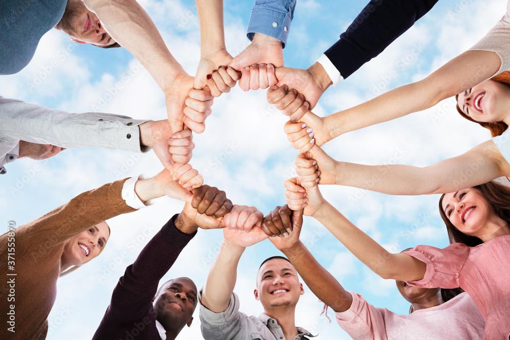 Fototapeta Multicultural And Multi Racial Huddle