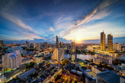 Fotografie, Obraz Cityscape in Bangkok city from roof top bar in hotel with Chao phraya river back