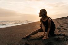 Woman On Beach Is Enjoying Ser...