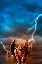Gargoyle Statue Over  Stormy S...