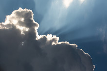 Sunbeams And Dramatic Clouds
