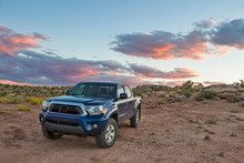 A Truck With Emblems Removed Parked In The Wilderness Of The Utah Desert At Sunset.