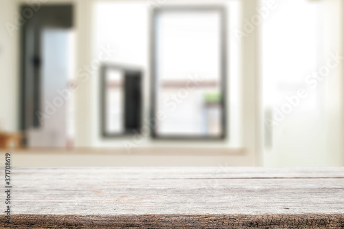Obraz Wooden desk space and blurry background of home window for product display montage. - fototapety do salonu