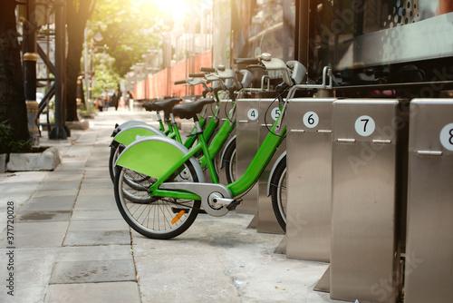 Green bicycle for rent in city / bike for rent. Slika na platnu