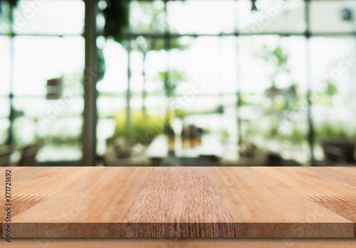 Obraz Empty wooden table top with lights bokeh on blur restaurant background - fototapety do salonu