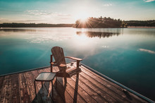 Muskoka Chairs Sitting On A Wo...