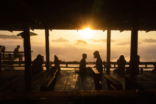 Silhouette Of Tourist On Wooden Terrace Of Noodle Shop During A Beautiful Early Morning Sky With Waves Of Fog At Baan Ja Bo Village Viewpoint Of Pang Mapha, Mae Hong Son, Northern Thailand.