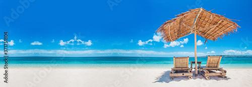 Slika na platnu Beach chairs and umbrella