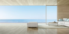 3d Render Of Large Window, Modern Living Room With Wooden Floor And Sofa Set On Sea Background.
