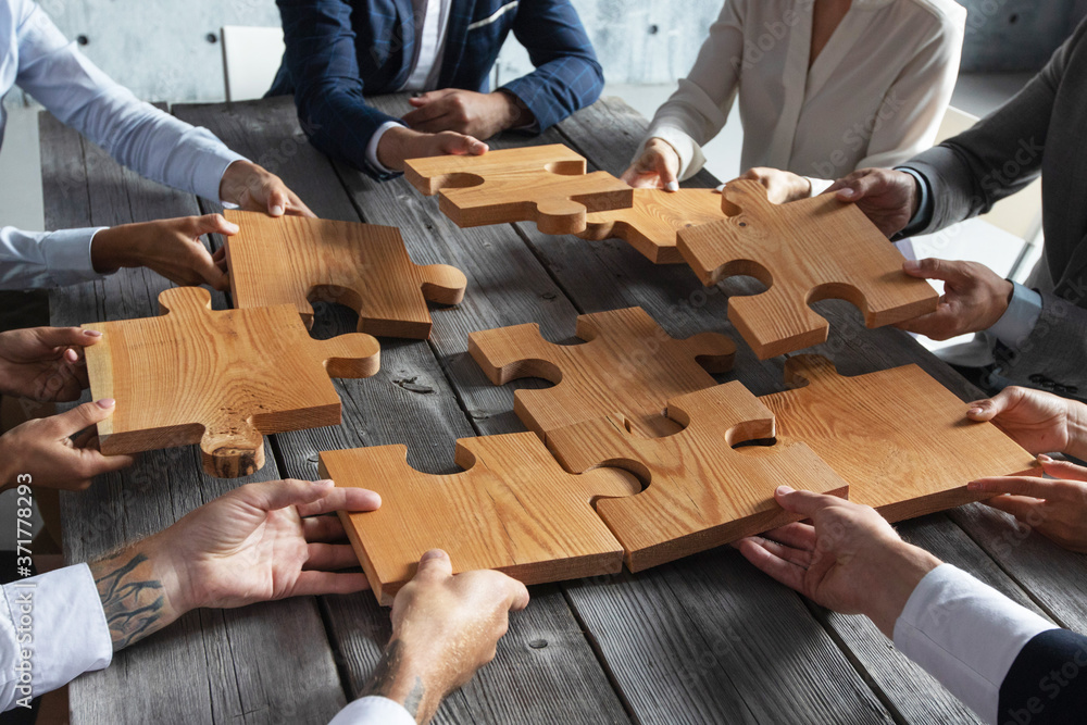 Fototapeta Business people and puzzle pieces