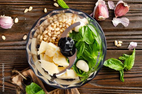 Obraz na plátne Ingredients for italian national traditional genovese pesto sauce in food processor bowl