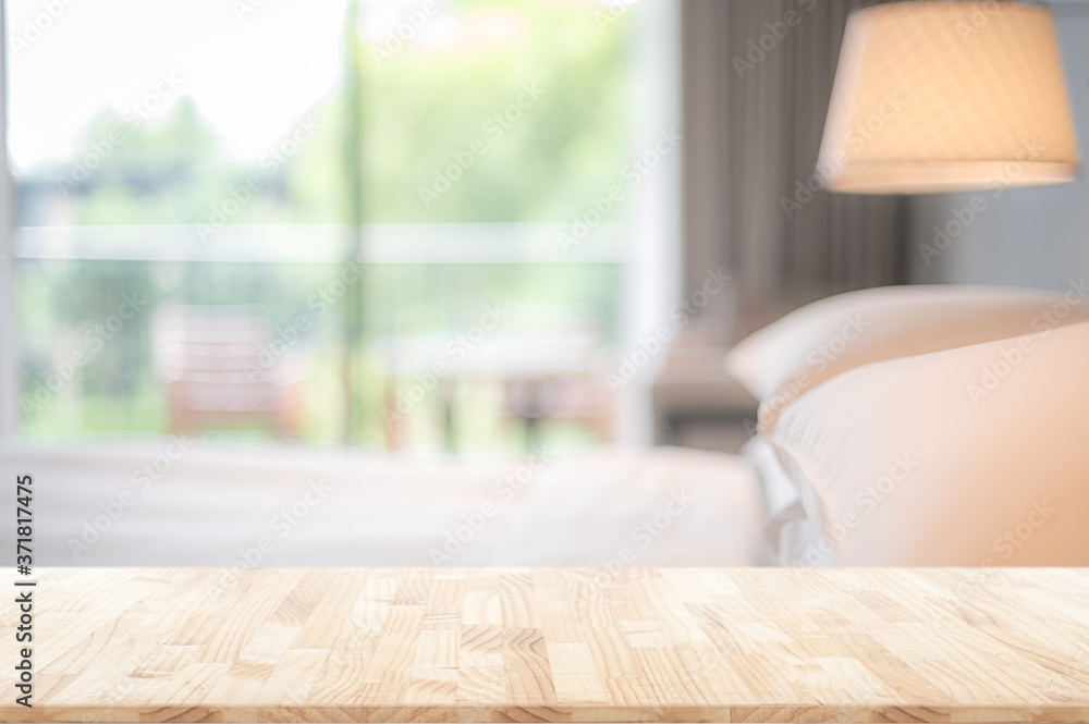 Fototapeta blurred bedroom interior background and wooden table top in front  for montage or display your products.