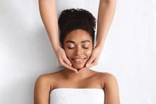 Therapist Making Lifting Facial Massage For Beautiful Black Lady