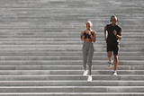 Fototapeta Na drzwi - Active Lifestyle. Black Jogger Couple Running Down On Urban Stairs, Training Outdoors