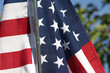 American flag in the breeze, close up on stars