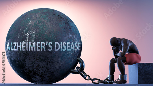 Fotografía Alzheimer's disease as a heavy weight in life - symbolized by a person in chains