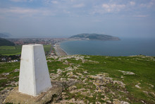 Summit Marker On The Little Orme, Llandudno. North Wales Hiking With A View Of Llandudno And The Great Orme