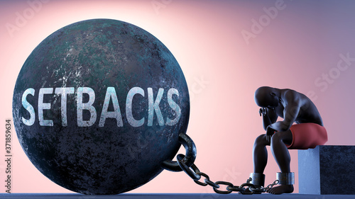Fotografie, Obraz Setbacks as a heavy weight in life - symbolized by a person in chains attached t