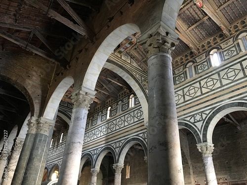 Florence, Tuscany, Italy - 07/14/2018: Basilica of San Miniato al Monte and the cemetery adjacent to the church. The place of rest of the author of