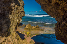 A View Out To Sea Between Wave-cut Boulders On Bathsheba Beach On The Atlantic Coast Of Barbados