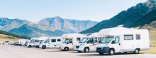 Summer Tourism With RV. Campers Parked In A Row In A Caravan Parking Area. Best Option For Travel In Times Of Coronavirus Pandemic.