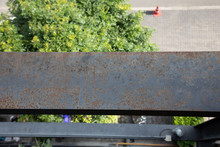 Top View And Close Shot Of Rusted Metal Beam Installed At High Level Shows The Beautiful Texture And Colorful Surface. The Steel Structure Has Been Abandoned Outdoor Which Is Deteriorated And Aged