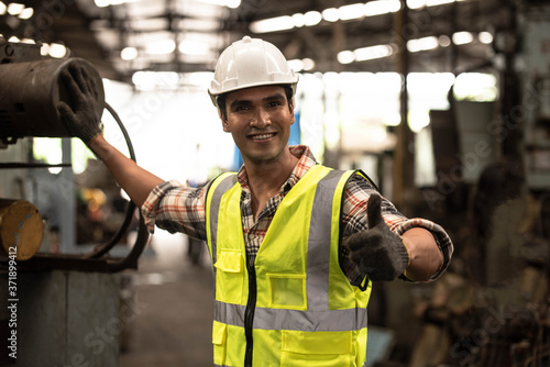 Fotografía Portrait of Asian technician  handsome man or industrial worker with hardhat or