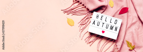 Valokuva Lightbox with Hello Autumn text, Cozy scarf and leaves on pastel banner